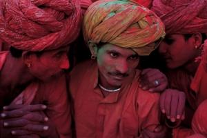 Rajasthani men participate in the the Hindu festival of Holi. 1996, Rajasthan, India; chromogenic development (Lambda) print; © Steve McCurry, courtesy George Eastman House