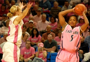 Players from both teams wore pink uniforms. This is Mashea Williams with the ball.