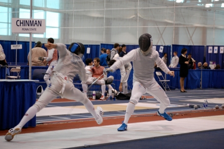 Penn State junior Nick Chinman (right) lost this bout, but he rebounded to win gold in foil.