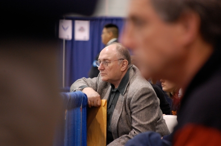Legendary Penn State coach Emmanuil Kaidanov watches a bout.
