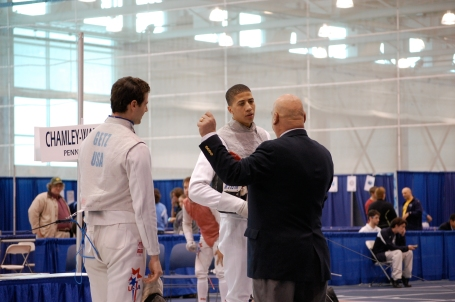 Miles Chamley Watson (center), a Penn State freshman, listens as an official explains a contested point. Chamley-Watson eventually lost to teammate Nick Chinman in the foil semifinals and finished tied for third.