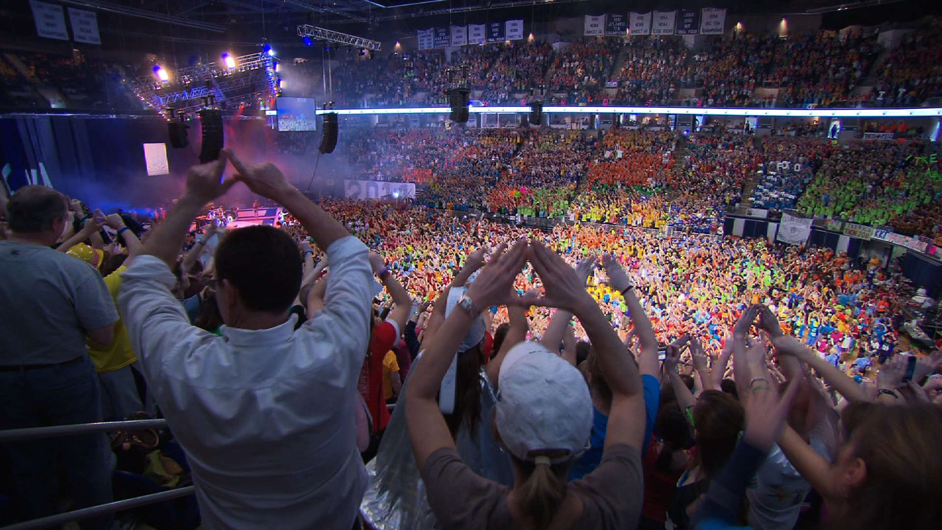 Students at the Bryce Jordan Center make the trademark diamond symbol during THON weekend — an image captured in the documentary that will debut this ...