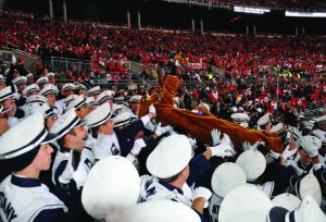 This Daily Collegian photograph shows the game --- and the Lion --- from the band's perspective.