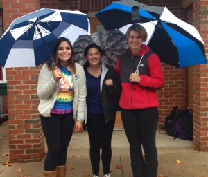 Sarah Seiler (left) and members from Phi Mu hold a spot for their sorority on West College.