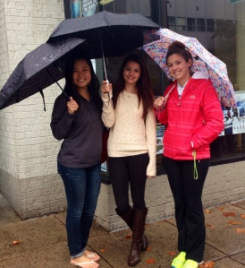 Members of Phi Beta Lambda hold their umbrellas up and try to stay dry while holding a prime spot for the parade.