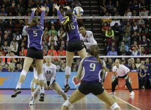 Deja McClendon gets a kill in this photo by Bettina Hansen of The Seattle Times.