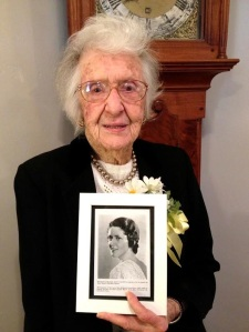 Peg Chalfant poses with her 1934 graduation photo.