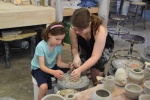 """Throwing"" on a potters wheel, with help from a ceramics undergrad."