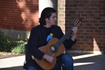 Music professor Jonathan Gangi performs in front of the Palmer Museum.