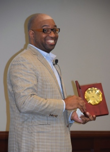 Alexander accepts the Lee Bennett Hopkins award Thursday at Paterno Library